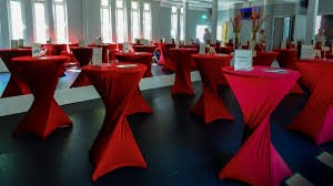 Table wrapped with red cloth